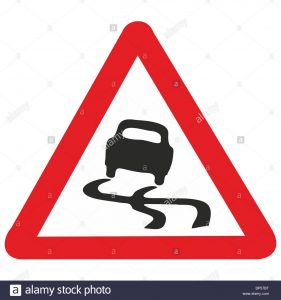 uk-road-sign-slippery-road-surface-risk-of-skidding-car-bp57bt
