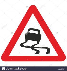 uk-road-sign-slippery-road-surface-risk-of-skidding-car-bp57bt